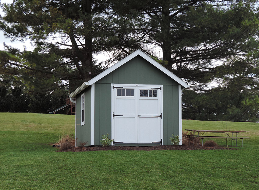 a frame shed with vinyl siding