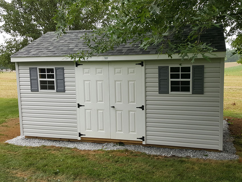a frame shed with double doors