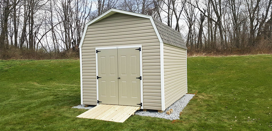 A Durable Shed Ramp High Wall Barn With Lawn Mower